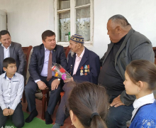 UzLiDeP faction's member visits participant of the Second World War